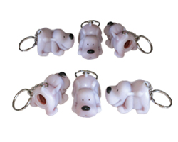 Pooping dog keychains, stunt dog keychains, collector keychains for the Stunt Dog Experience, Extreme Canines Stunt dog show, and the Stunt Dogs of America